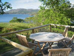 Dining area on the patio with Gairloch in the background